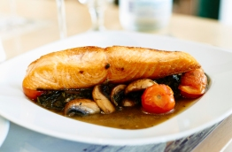 Poached fish with mushroom sauce